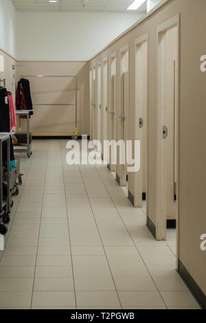 J.C. Penny's lady's indoor dressing room with many dressing stalls. USA. - Stock Image