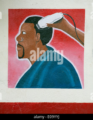 Painting on wall advertising Hairdresser and Barber shop, Kigali, Rwanda - Stock Image