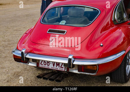 Rear of a red Jaguar E Type V12 Coupe. - Stock Image