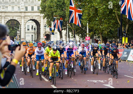 Cyclists in the Prudential RideLondon 2018 race cycling down The Mall before the start of the Race, London, UK - Stock Image