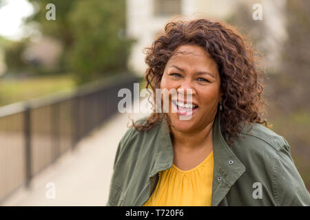 Mature African American woman smiling. - Stock Image