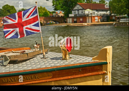 Tourist pleasure cruiser Mayflower flying the Union Jack flag  from the bows, on a summer Saturday in Stratford - Stock Image