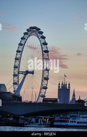 London Eye and Palace of Westminster after sunset,  London, England, UK - Stock Image