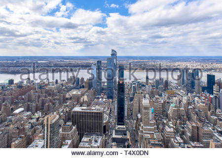 New York city, USA, urban skyline with the Hudson River in the background. Wide angle image with clouds in the sky - Stock Image