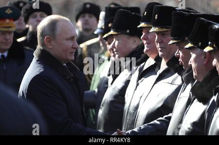 Moscow, Russia. 23rd Feb, 2019. Russian President Vladimir Putin greets veterans during a wreath ceremony at the Tomb of the Unknown Soldier at the Kremlin Wall to honour the memory of fallen soldiers on Defender of the Fatherland Day February 23, 2019 in Moscow, Russia. Credit: Planetpix/Alamy Live News - Stock Image