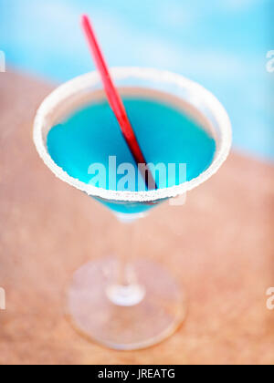 A blue margarita by a pool. Old San Juan,Puerto Rico. - Stock Image