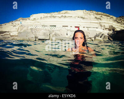 young female teenager swimming on the surface of the Mediterranean Sea - Stock Image