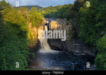 Teesdale, County Durham, UK.  21st June 2019. UK Weather.  The rising sun illuminates the River Tees at High Force on the morning of the summer solstice. Credit: David Forster/Alamy Live News - Stock Image