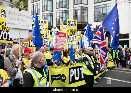 Marchers and security at People's Vote March, London, England - Stock Image