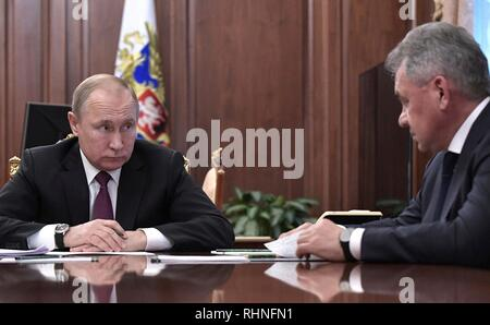 Moscow, Russia. 02nd Feb, 2019. Russian President Vladimir Putin listens to Defense Minister Sergei Shoigu during a meeting along with Foreign Minister Sergey Lavrov at the Kremlin February 2, 2019 in Moscow, Russia. The meeting discussed the Treaty on the Elimination of Intermediate-Range and Shorter-Range Missiles, after the United States announced their plan to withdraw from the disarmament agreement in place since 1988. Credit: Planetpix/Alamy Live News - Stock Image