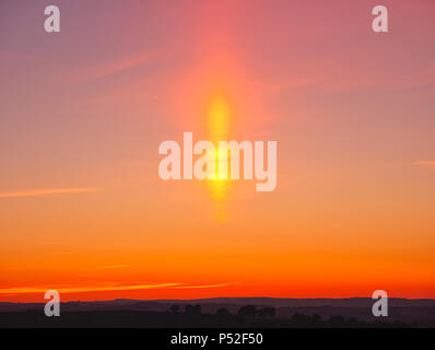 Brassington, Derbyshire, UK. 24th June, 2018. Weather UK: sun pillar solar column during an amazing sunset at Harborough Rocks near Brassington & the High Peak Trail, Derbyshire, Peak District National Park Credit: Doug Blane/Alamy Live News - Stock Image