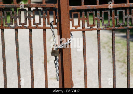 A locked gate - Stock Image