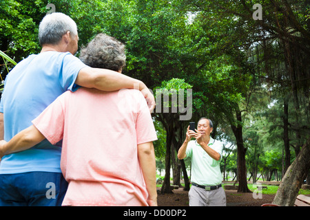 happy seniors taking picture by smart phone in the travel - Stock Image