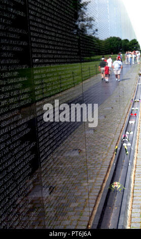 The Vietnam War Memorial Wall relecting visitors in Washington, DC - Stock Image