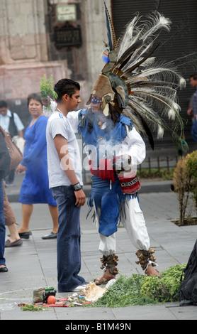 Mexican Shaman Performing Spiritual Cleansing Ceremony, Zocalo Square, Plaza de la Constitucion, Mexico City, Mexico - Stock Image