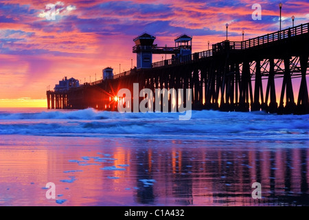 USA. The sky is so vibrant, at this incredible sunset. Captured at the Oceanside Pier in Southern California. - Stock Image