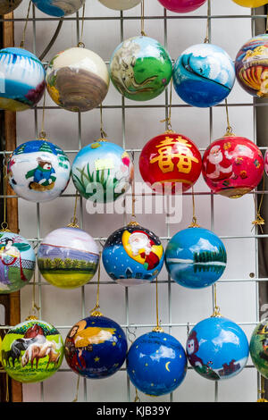 Xmas baubles on sale in Chinatown Singapore - Stock Image