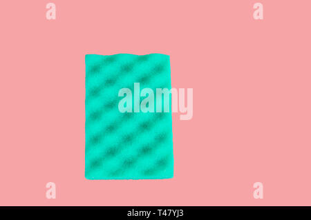 Green sponge for cleaning, isolated on pink-coral background, clipping path included, top view, copy space, flat lay. - Stock Image