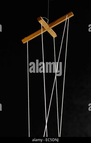 strings of a marionette - Stock Image