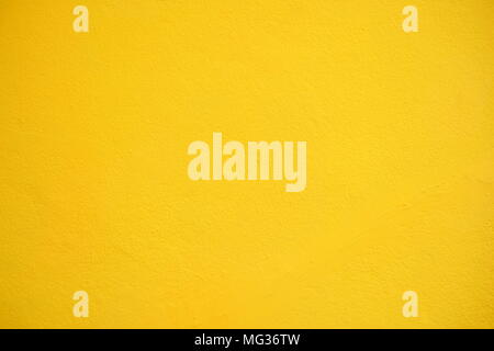 Yellow Concrete Wall Background. - Stock Image