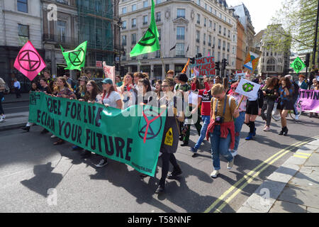 A group of Extinction Rebellion Youth protestors march around the south side of Trafalgar Square, central London. One of many marches against climate  - Stock Image