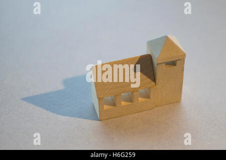Wooden blocks representing a church like building. - Stock Image