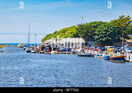 7 JUly 2018: Bude, Cornwall, UK - Bude Canal and some of its attractions, boats, people, during the summer heatwave. - Stock Image