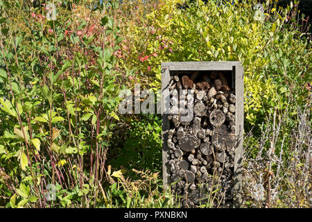 Bug hotel for insects to hibernate over winter England UK United Kingdom GB Great Britain - Stock Image