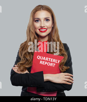 Businesswoman in black suit holding business report on white background - Stock Image