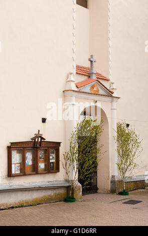 Church informational display cabinet in Janowiec village, Poland, Europe, wooden showcase with mass schedule and - Stock Image