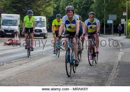 Hook, Hampshire, UK. 26th May 2018. Cancer patient and father of three Gareth Lancaster (40) and a team of cyclist from Cornwall are riding 240 miles of the Trafalgar Way from Launceston to Admiralty Arch, London to raise funds for Sarcoma UK. Over £13k has already been pledged. Despite major surgery last year in Birmingham Orthopaedic Hospital to remove a tumour and much of the front of his pelvis, Gareth's cancer has returned and he will require further surgery after the ride. Photo: Leaving Hook after the rest break. Credit: Images by Russell/Alamy Live News - Stock Image