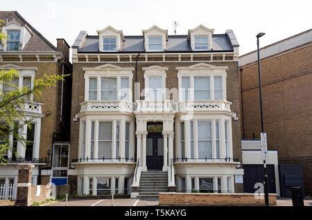 Large Victorian four story house with basement newly converted into flats, Highbury, London Borough of Islington England Britain UK - Stock Image