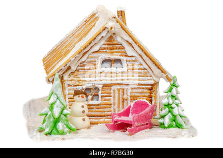 New Year's fabulous house and decorations from cookies and sugar on a white background - Stock Image