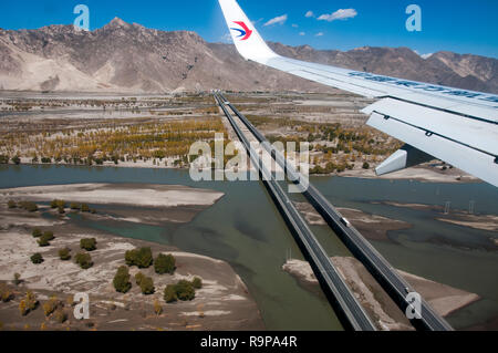 Aerial over an expressway bridge spanning the Yarlung Tsangpo outside Lhasa, Tibet, China - Stock Image