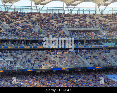 West Coast Eagles football club members and spectators seated in the grandstand of Optus Stadium Perth WA Australia. - Stock Image