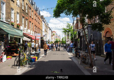 London, England, UK - June 3, 2019: Pedestrians browse shops and restuarants on Exmouth Market in London. - Stock Image