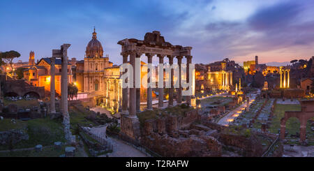 Panoramic view of ancient ruins of a Roman Forum or Foro Romano at sunsrise in Rome, Italy. View from Capitoline Hill - Stock Image