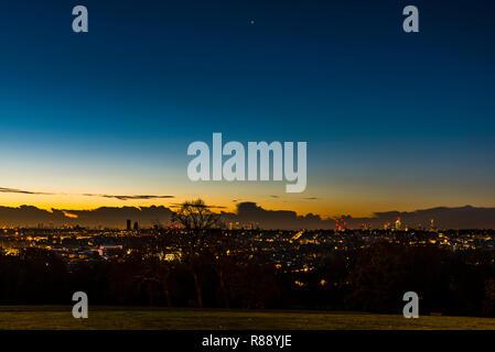 Dawn over the London skyline from Alexandra Palace Park, London, UK - Stock Image