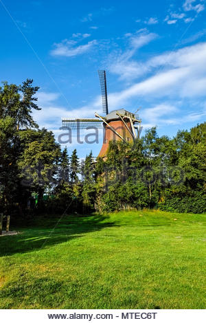 Traditional windmill in Ramsloh, Saterland, Lower Saxony, northern Germany. - Stock Image