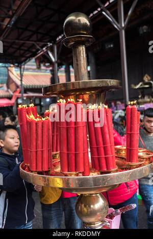 Huge candlesticks for Lunar New Year celebrations at Longshan Temple in Taipei, Taiwan. - Stock Image
