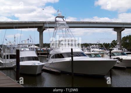 Luxury yachts moored at The Wharf Marina in Orange Beach, Alabama, USA. - Stock Image