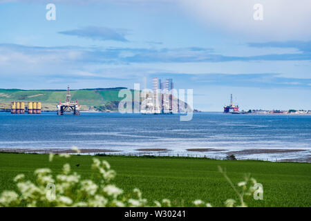 North Sea oil riggs / drilling platforms offshore in Cromarty Firth. Cromarty, Black Isle, Ross and Cromarty, Highland, Scotland, UK, Britain - Stock Image