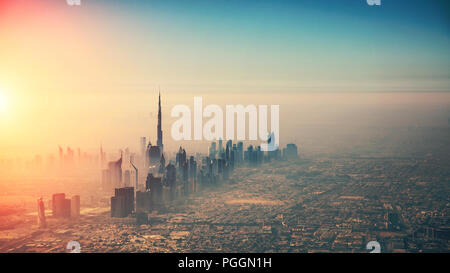 Aerial view of Dubai city in sunset light. Panoramic view. Dubai is the biggest and most modern city in UAE. - Stock Image