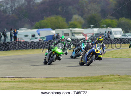 East Fortune, UK. 14 April, 2019.  Through the Esses in Scottish Lightweights race at East Fortune Raceway, during the opening rounds of the 2019 Scottish Championships, Melville Open and Club Championships. Credit: Roger Gaisford/Alamy Live News - Stock Image