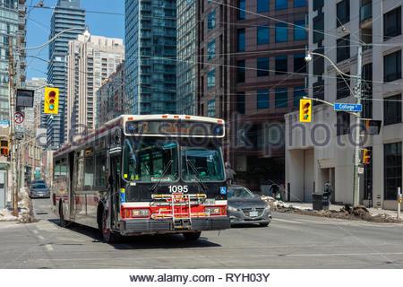 Toronto TTC bus on Bay Street at College street in Toronto Ontario Canada - Stock Image