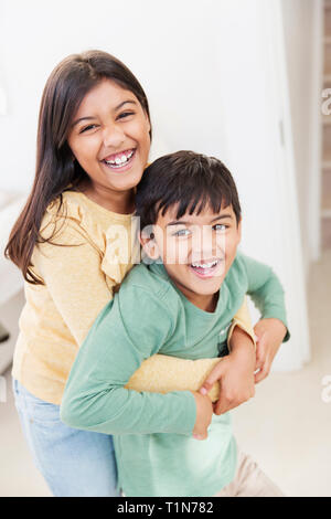 Portrait happy brother and sister - Stock Image