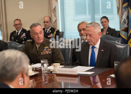 U.S. Secretary of Defense James N. Mattis meets with the Minister of Defense of Indonesia Ryamizard Ryacudu at the Pentagon in Washington, D.C., Aug 28, 2018. (DoD photo by U.S. Army Sgt. Amber I. Smith) - Stock Image