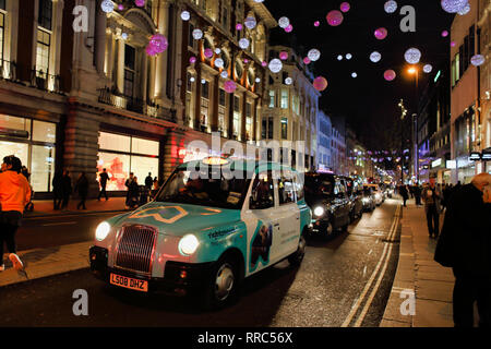 Taxi's on Oxford Street at night, London, England, UK - Stock Image