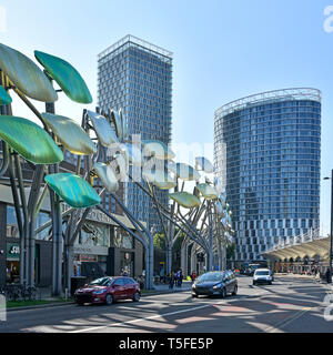 Stratford Broadway high level Shoal sculpture opposite bus station new modern high rise office & apartment building in Newham  East London England UK - Stock Image