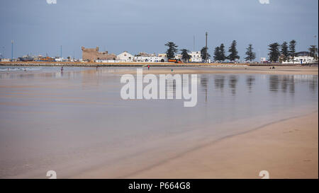 Essaouira beach in Morocco with the ancient Medina in the background - Stock Image